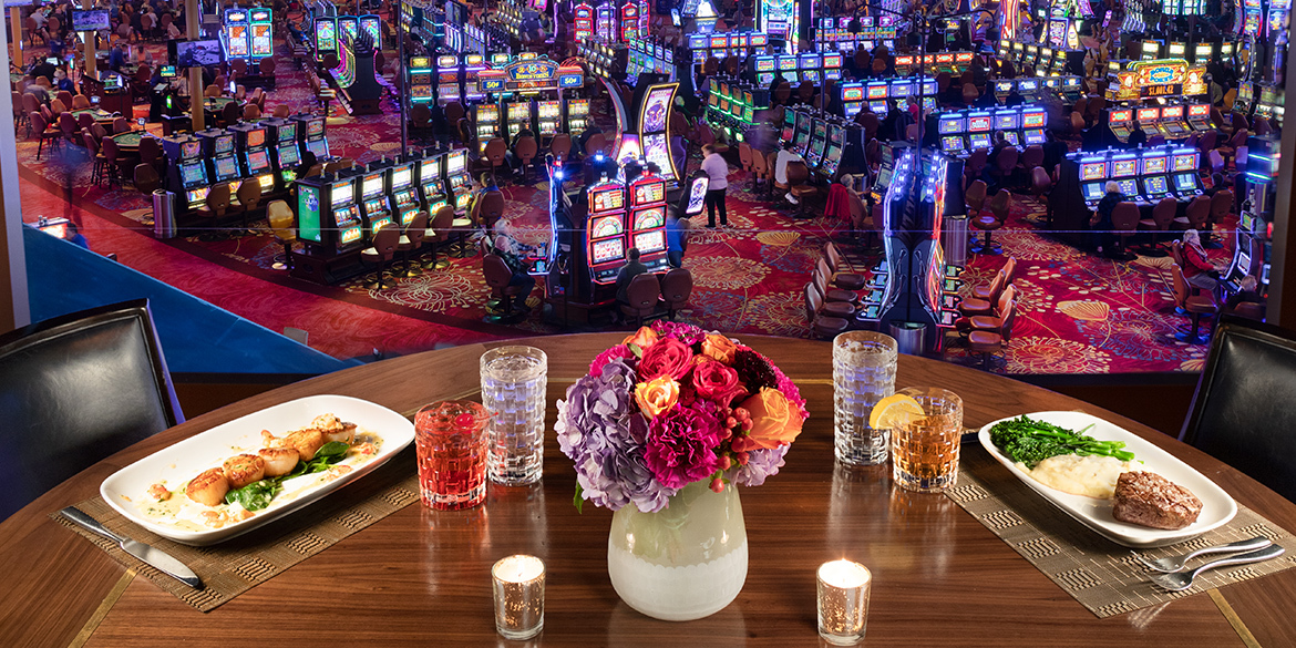 Table at Western Door Steakhouse with view of the casino floor