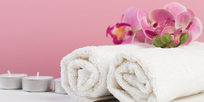 photo of towels and flowers at spa